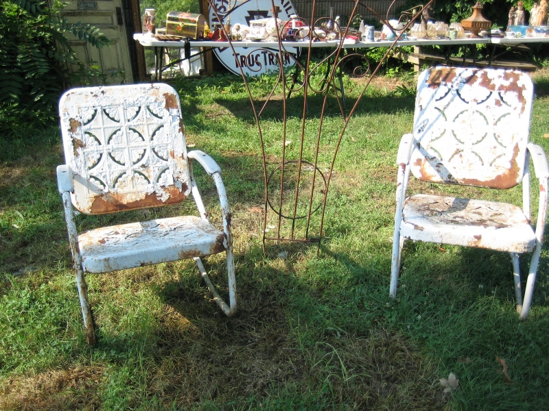 rusty neglected outdoor chairs that are not made of stainless steel